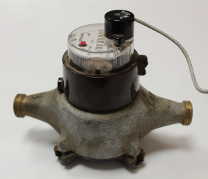 An example of a typical water meter. The meter is connected to your water lines on either side of the meter.